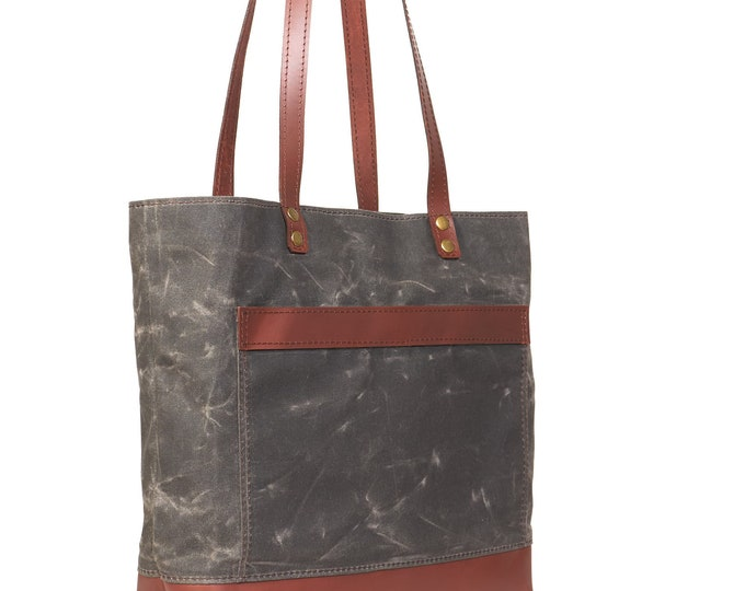 Waxed canvas tote bag with leather handles in dark brown
