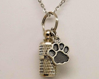 Pet memorial jewellery etsy au capsule urn with paw print charm pet urn necklace in stainless steel pet ashes aloadofball Images