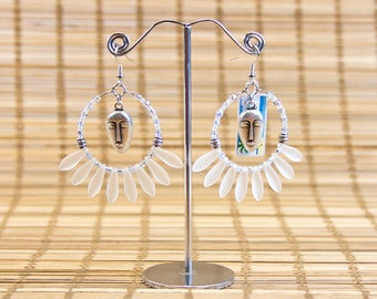 Masks and transparent daggers earrings