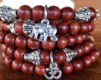 Boho stacker set of 5 stretch yoga bracelets. Five stacking bracelets in brown turquoise 6mm beads with ohm and lucky elephant charms