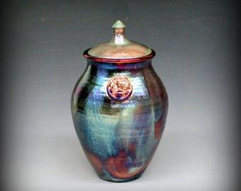 Raku Urn or Lidded Vase with Sun and Moon Motif in Metallic Iridescent Colors