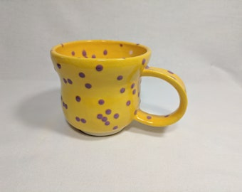 Ceramic 10 ounce Mug with Violet Polka Dots on Golden Yellow Glaze.