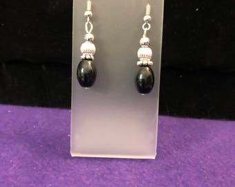 Silver toned and black drop earrings.