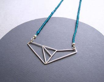 Solid silver wire geometric pendant on fine dark green glass beads
