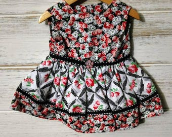 "18"" doll black & white with floral dress"
