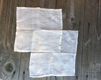 Pair of old, delicate white handkerchiefs