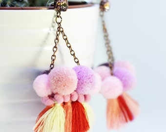"""""""Gipsy de Noiantri"""" earrings pink and lilac with pom pom and tassels."""