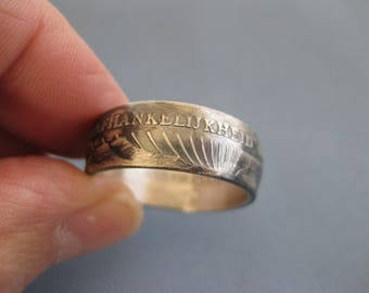 Coinring muntring made of a  10 guilder 1976 Suriname