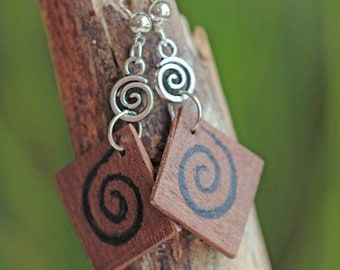 Recycled wood decorated with a spiral pattern, spiral silver bead earrings