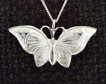 Filigree pendant with butterfly including silver necklace. Original 70s!