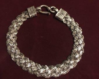 sterling silver bracelet, Indian one of a piece work. Braid bracelet