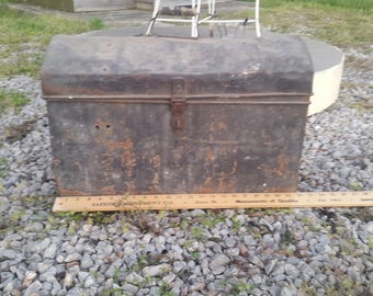 Very Old metal tool box with wooden handle.