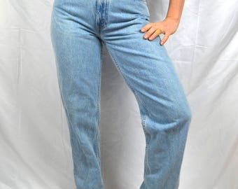 Vintage 80s Levis High Waisted Light Wash Denim Jeans - Orange tag