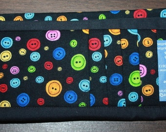 Buttons on Black Flat Wallet