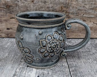 Grey mug with paisley flowers