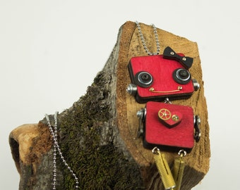 Red robot pendant with heart