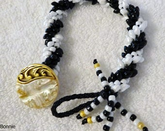 Black and White Beaded Bracelet with Gold Pearl Button
