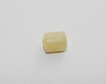 Yellow calcite cylinder 13 by 10 mm.