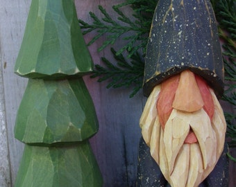 Hand Carved Christmas Gnome with carved tree... 6 inches tall and 2 inches wide.