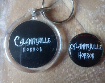 Calamityville Horror keyring and button badge