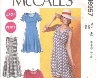 McCall's 6957 Size 6, 8, 10, 12, 14 Women's sewing pattern. Knit dress, sleeveless, short or long sleeves, with optional belt and hi-low hem