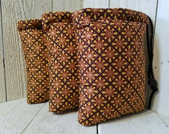 Shiny maroon padded pipe bag size large