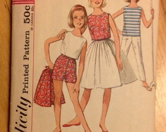 Vintage Girl's skirt, blouse, top and blouse in two lengths Simplicity 4967