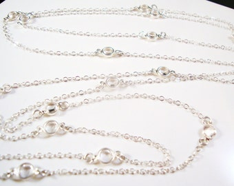 Rockin the Swarovski crystals-luxurious-long station necklace, sterling silver