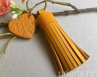 Tassel keychain / tassel keyring in yellow cow leather skin and  yellow genuine ostrich leg skin top. Tassel with heart charm