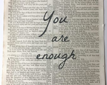 """Antique Bible page with """"You are enough"""" printed"""