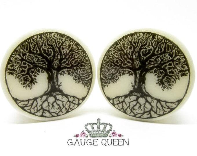 "Tree Of Life Plugs / Gauges. 4g /5mm, 2g /6.5mm, 0g /8mm, 00g /10mm, 1/2"" /12.5mm, 9/16"" /14mm, 5/8"" /16mm, 3/4"" /19mm, 7/8"" /22mm, 1"" /25mm"