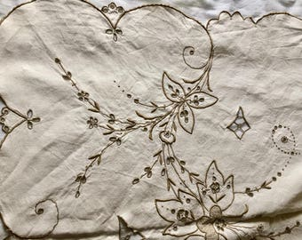 Vintage rectangular off white linen tablecloth with coffee colour embroidered floral design and scalloped edges