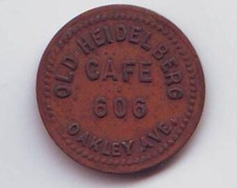 Old Heidelberg Cafe 606 Oakley Ave Token Good for 5 Cents in merchandise
