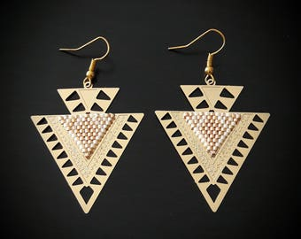 Gold prints, white and gold earrings