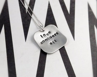 sterling silver love conquers all necklace - love conquers all - love necklace - love conquers - faith necklace - love conquers