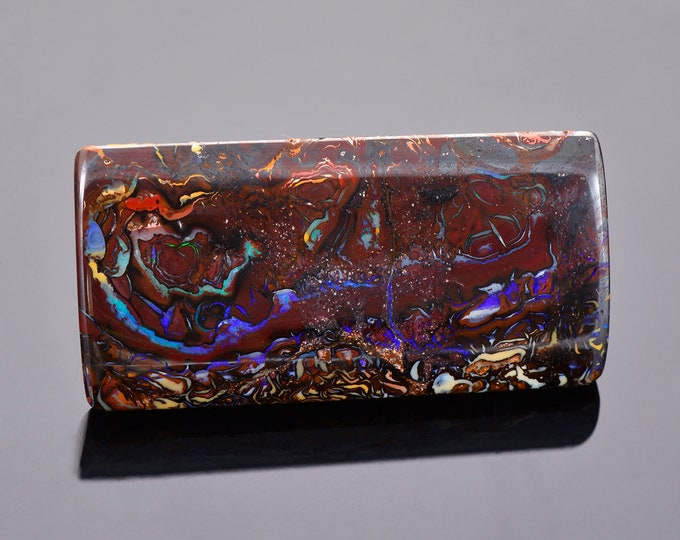 Fascinating Blue Purple Boulder Opal from Australia, 69.89 cts., 44 x 22 mm., Rectangle Cabochon