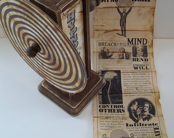 The Astounding Hypno-Wheel magical mind control device. Vintage style decor.