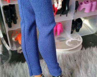 Barbie size shoes one size fits all doll mentioned