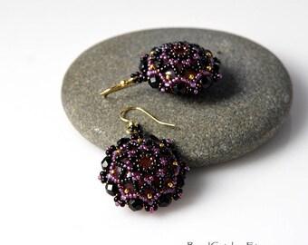 Beadwoven mandala earrings in black and purple