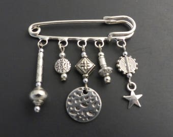 Silver Star brooch and round beads