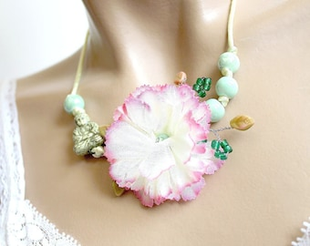 Pink ceramic Buddha necklace and large white petal flower. Zen
