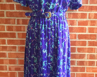 Vintage 80s Lady Carol purple dress with teal, pink, and white floral print. Size 12