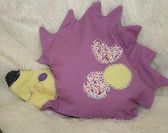 """heating pad shape """"hedgehog"""" color purple in the grain of rice and lavender flowers"""