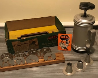 Vintage Mirro Cookie Press with wooden stand, and original box bottom