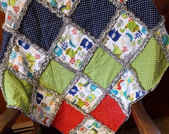Dinosaurs, kitties elephants and polka dots oh my.  Bright colored rag quilt.  perfect for comfort, car seat, stroller, pram, floor, lap.