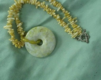 Yellow coral necklace with jasper pendant.