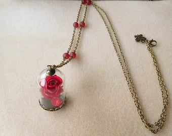 Beautiful bronze necklace, pink globe and red beads