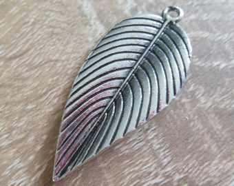 accessory shaped silver metal leaf pendant