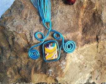 Blue necklace made of aluminum with its yellow polymer clay bead