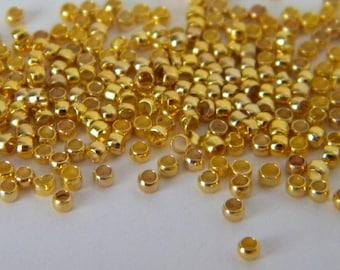 100 crimp Golden shape 2 mm (1 g) barrel beads